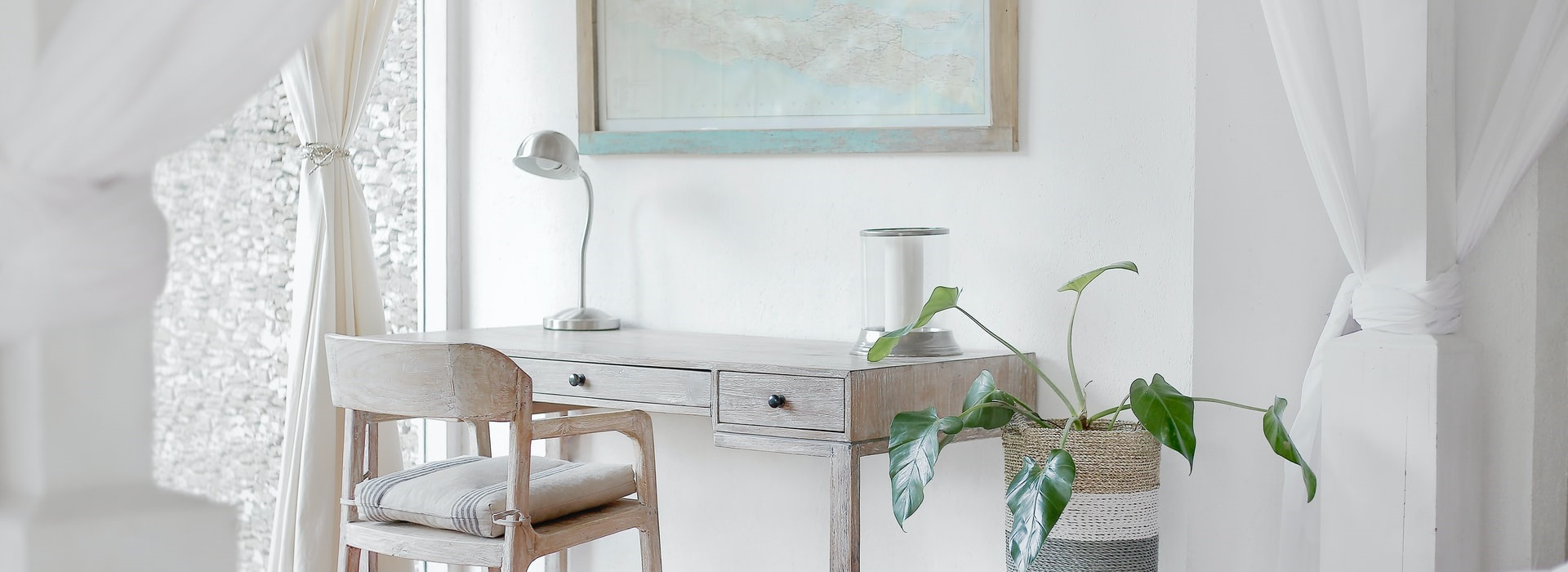 desk and chair against a white wall