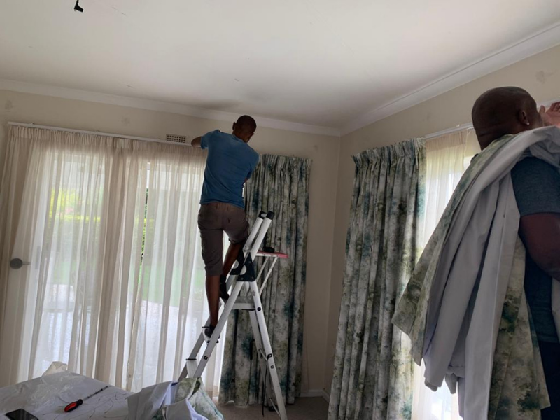 Curtains being hung